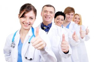 Medical doctors giving thumbs-up